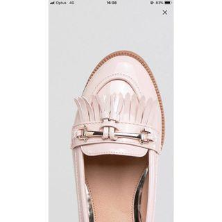 Nude / pink leather loafers with tassel detail