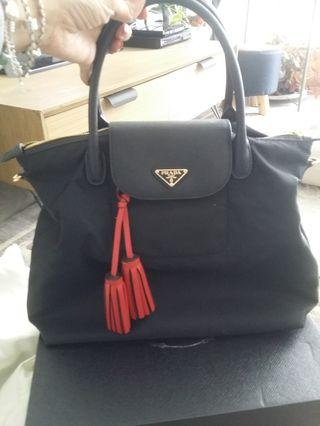 Prada Boutique Quality (with an authentic Coach leather tassel)