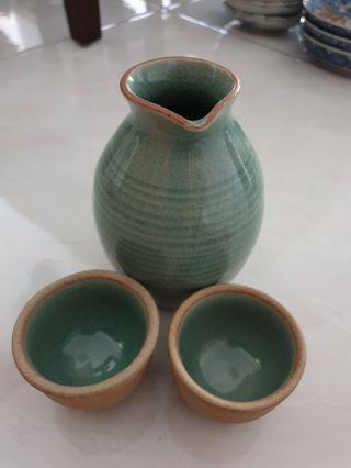 Sake bottle and 2 cups