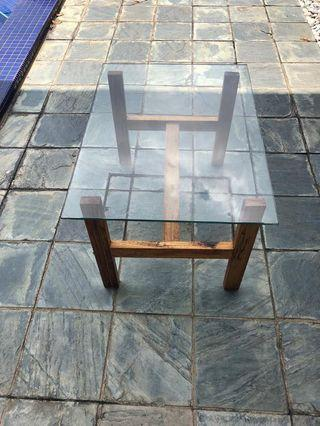 Glass table with wooden legs.