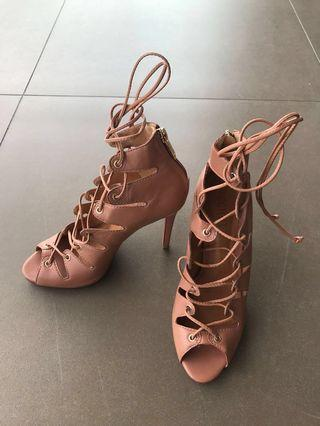 Schutz high heeled leather lace up booties