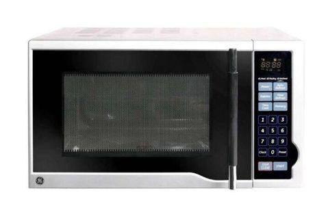 Brand new GE Digital Microwave Oven