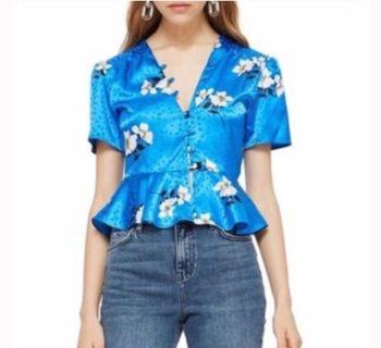 Blue Blouse with White Flowers