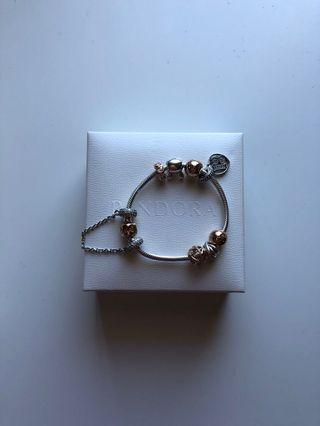 Pandora rose gold and silver charm bracelet