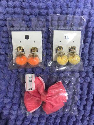 Two brand new ear rings and hair clip