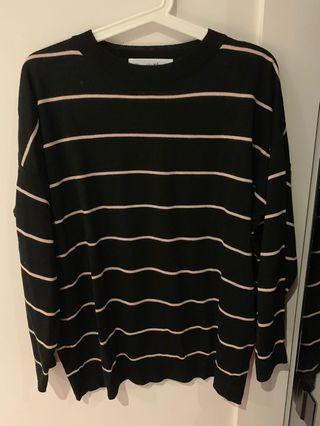 black and pink striped sweater