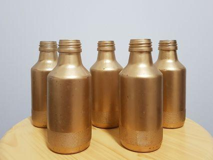 Gold painted glass bottles