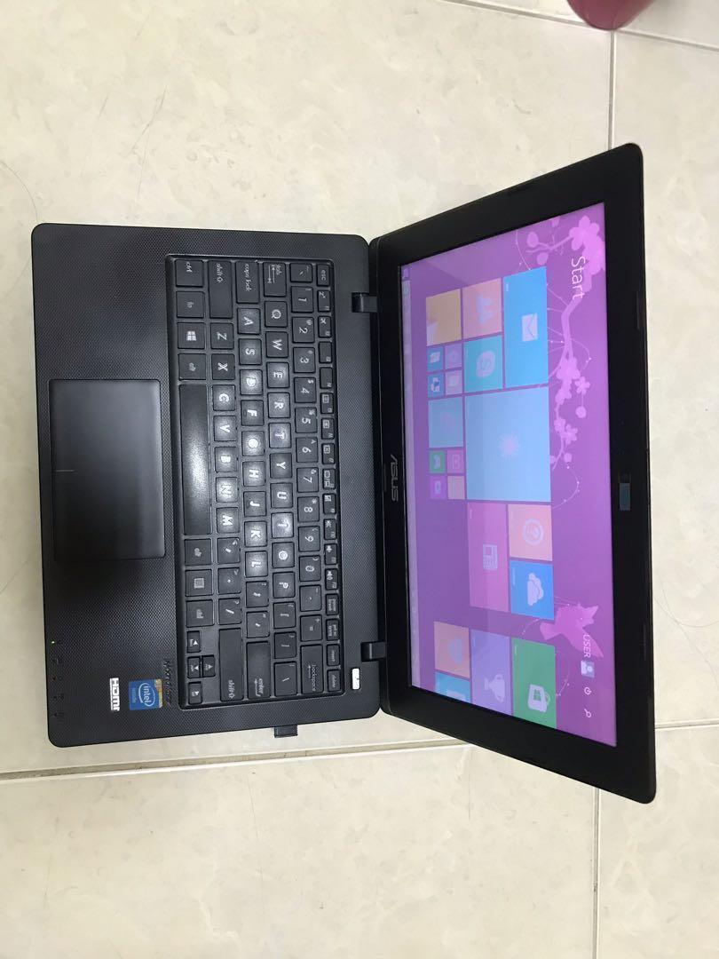 Laptop asus x200M hitam