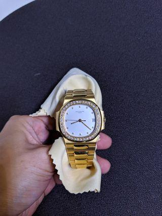 Patek Philippe Lady's Yellow Gold Diamond Nautilus Ref 4700