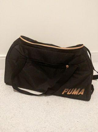 Black and gold Puma duffel bag