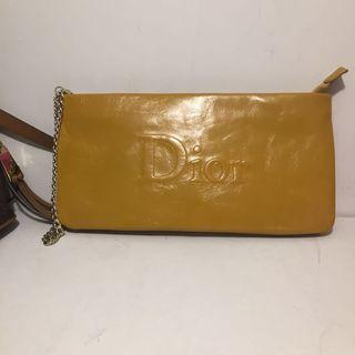 Yellow Dior purse with wristlet