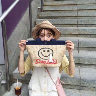 夏。韓國官網同款 每天都要好心情 笑臉刺繡流蘇 大容量撞色手提草编包-Euphoria Store