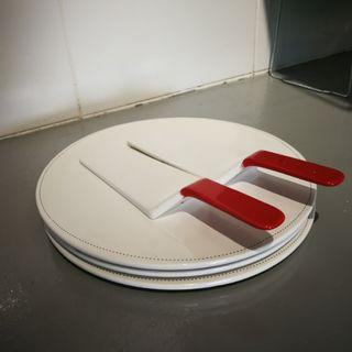 white cake ceramic plate with slicer.