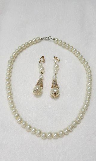 White pearls necklace and earrings