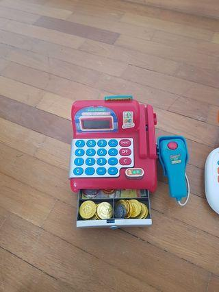 toy cash register with toy money