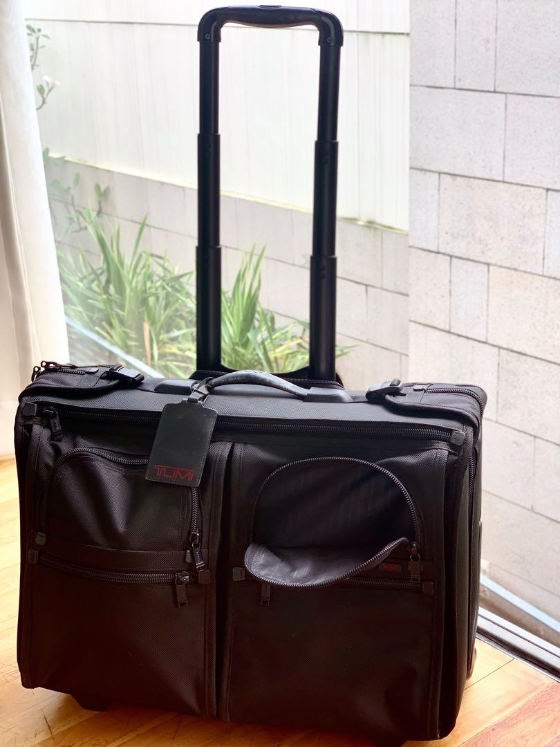 Authentic Tumi 4 Wheeled Carry-On Luggage