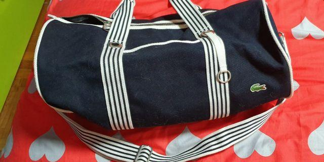 🚚 Lacoste duffle bag with sling