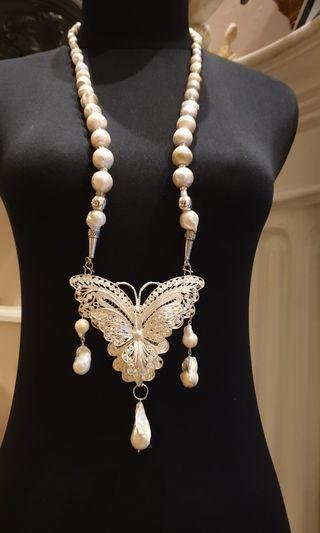 Fresh water pearl, baroque, and silver necklace