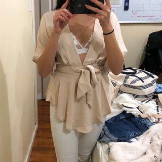 nude low cut out top