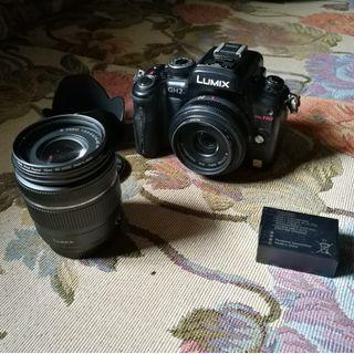 Panasonic GH2 with 20mm f1.7  and 14-42 lens. 2 batteries and other FOC items