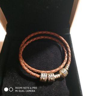 正品潘朵拉皮繩+2太陽扣珠