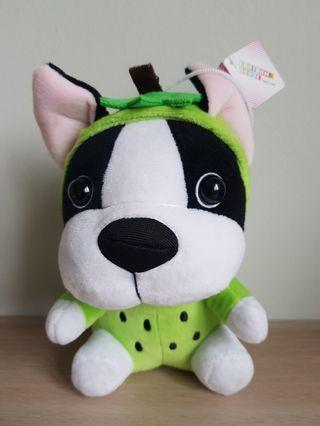 Dog with green apple costume