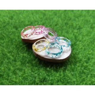 Handmade translucent resin ring with dried flowers