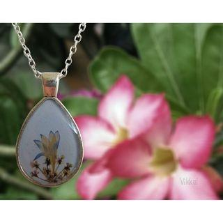 Handmade secret garden resin necklace
