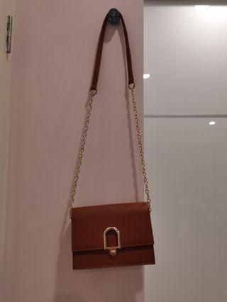 Brown Sling clutch bag