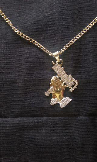 Uzi praying hand necklace