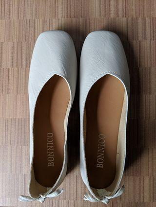 beige flats with cute bowtie detail