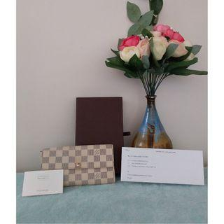 Pre owned authentic Louis Vuitton white wallet