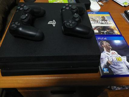 1tb Playstation 4 pro 2 controllers 2 games