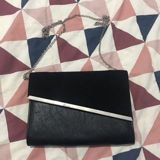 Colette black and silver clutch bag