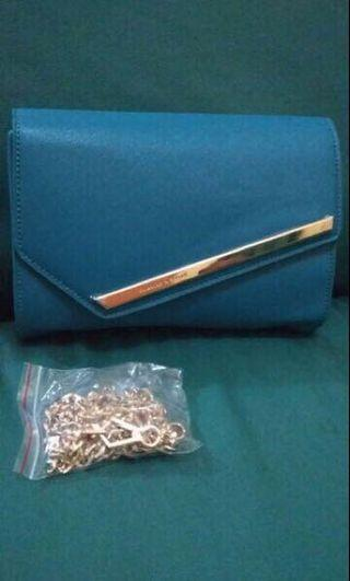Tas/clutch charles and keith