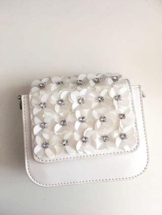 Charles and Keith white floral mini sling bag