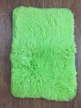 Green door mat