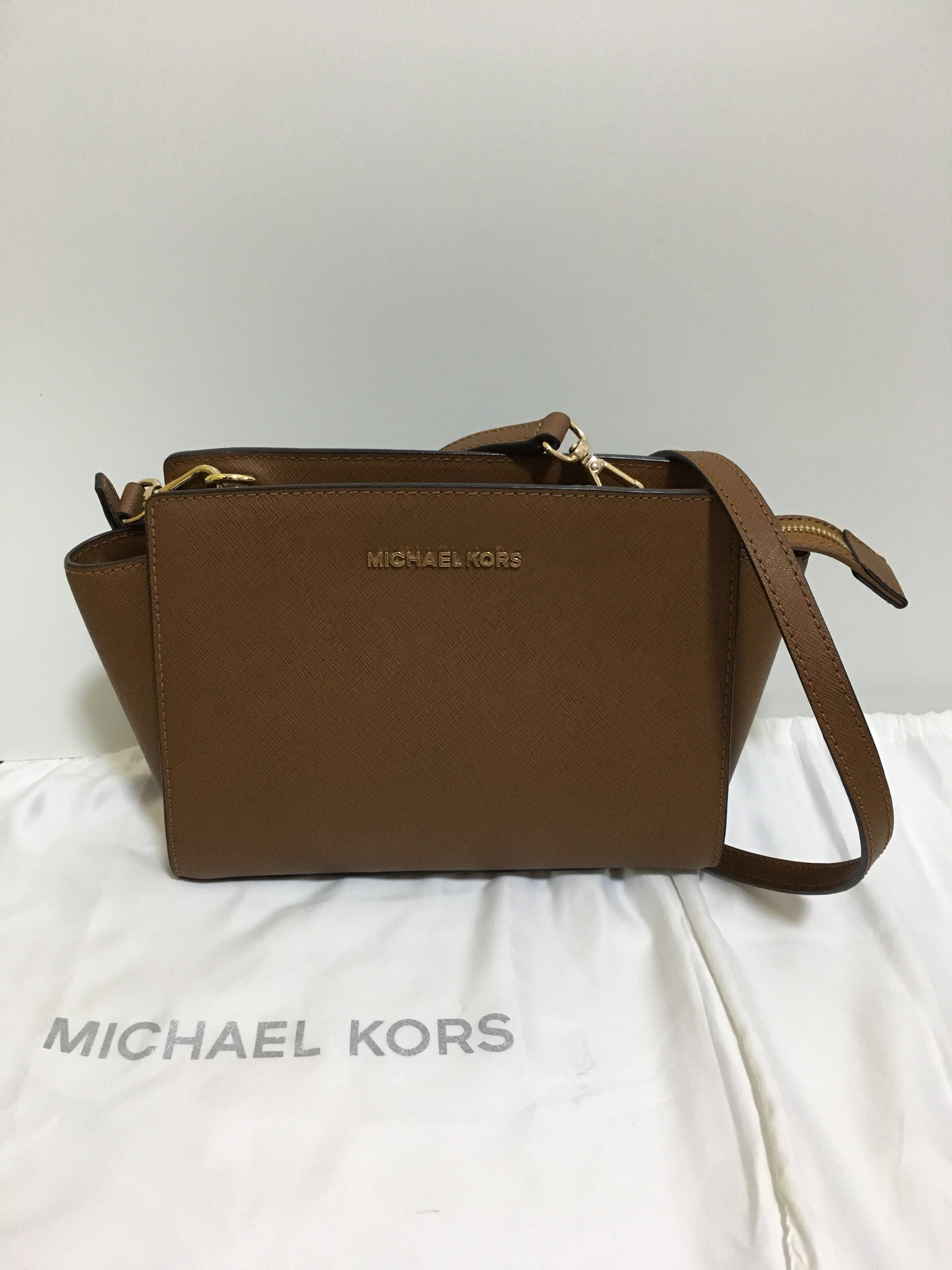 c10a30c65 Authentic Michael Kors Selma Mini Saffiano Leather Crossbody Bag, Women's  Fashion, Bags & Wallets, Sling Bags on Carousell