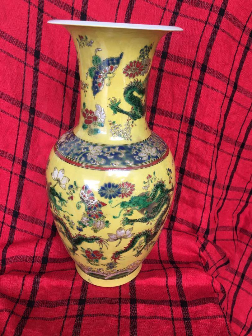 Qing era Kangxi mark famille rose dragon vase with