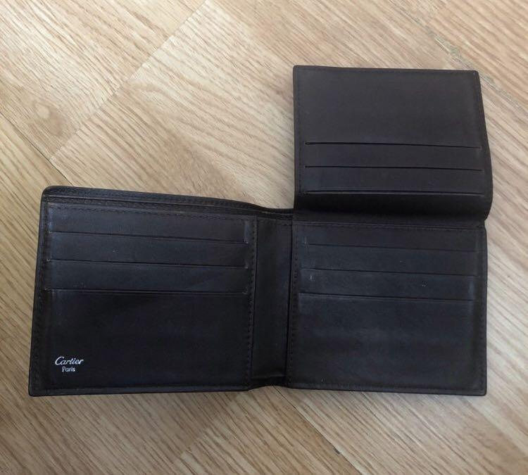 SANTOS DE CARTIER, 9-CREDIT CARD WALLET  SANTOS DE CARTIER Take a look at the Santos de Cartier leather goods designed for men. Timelessly elegant. SANTOS DE CARTIER SMALL LEATHER GOODS, 9-CREDIT CARD WALLET