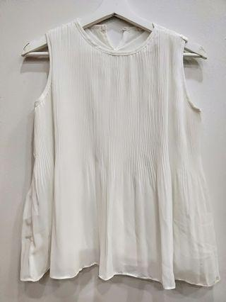 Sleeveless pleated white top