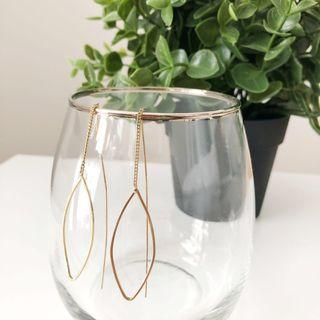Delicate gold thread through earrings
