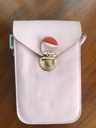 Miniso sling clutch