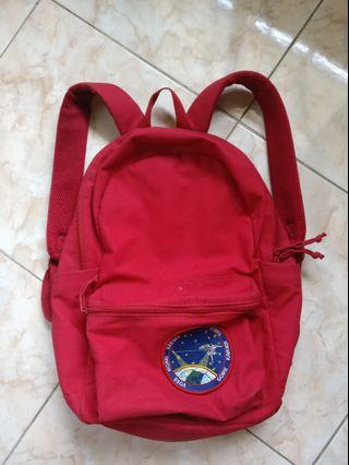 Uniqlo Red Backpack with NASA patch
