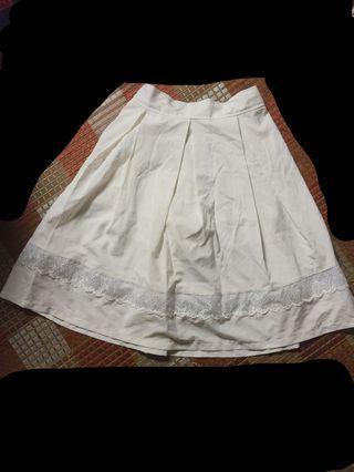 Knee length white skirt