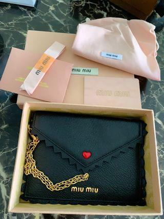 Brand new Miu Miu wristlet with everything shown (N/A)