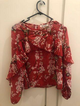 Women's blouse with frills