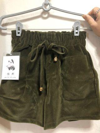 Green suede shorts