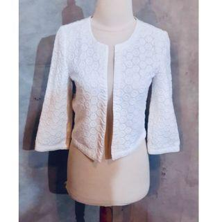 White laced buttonless jacket