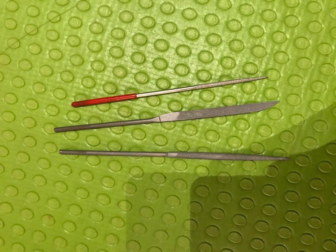 Wires, wire cutter, glue gun sticks, sanding laper